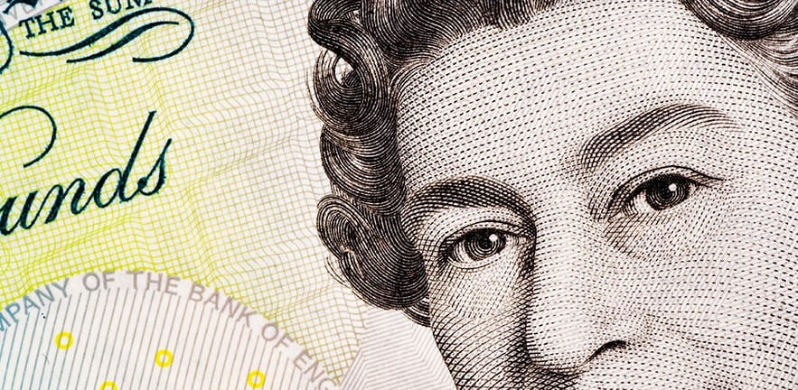 Close up of a five pound note, showing the head of Queen Elizabeth II