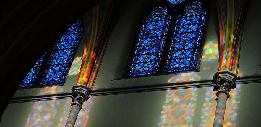 Morning sunlight shining through the stained glass windows.