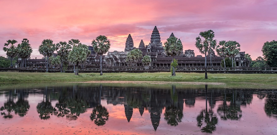 The pink hues of Sunrise over the Angkor Wat temple in Siem Riep, Cambodia.