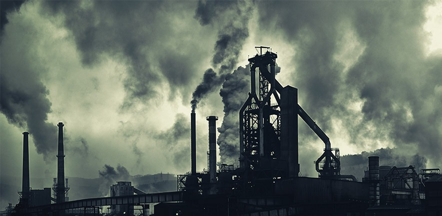 Photo of factory releasing CO2 emissions.
