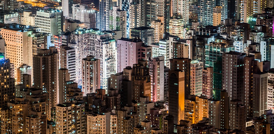 Buildings lit up at night on the Kowloon Peninsula on Hong Kong.
