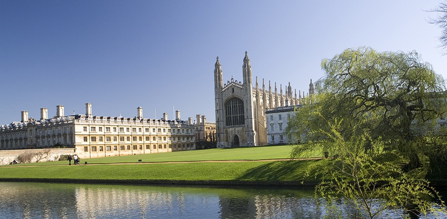 Spring time image of Kings and Clare College, taken from the Backs with River cam in the foreground.